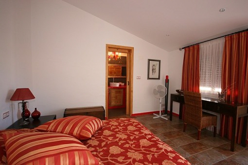 Light bedroom with bathroom en suite
