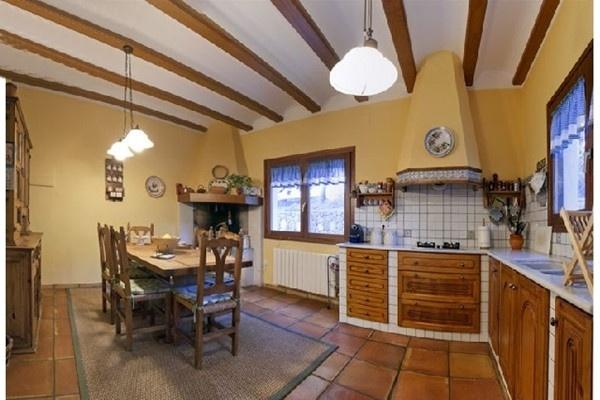 The spacious, light-flooded kitchen