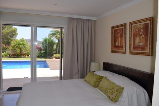 One of the bedrooms with access to the pool
